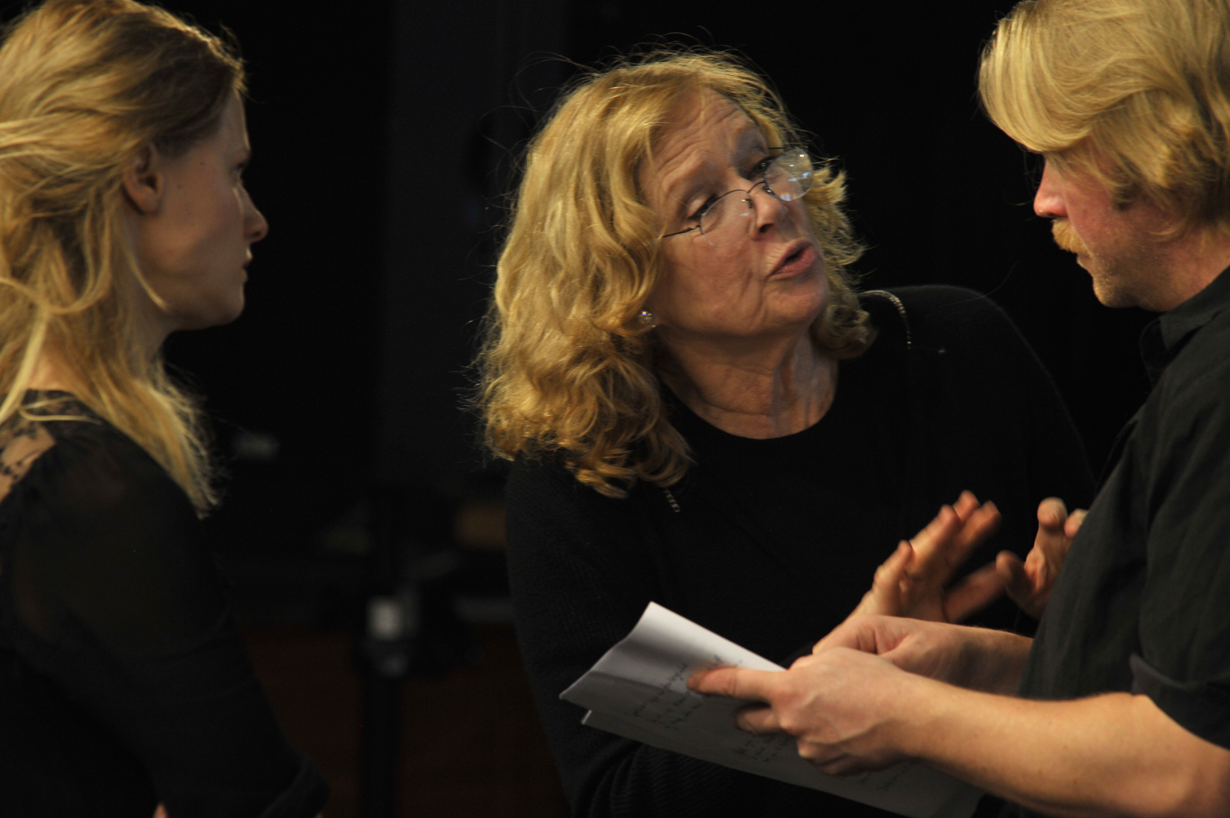 Liv Ullmann discussing with two actors